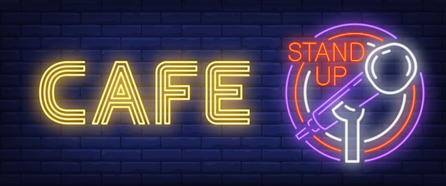 Cafe stand up neon sign. glowing bar microphone in circle frame Free Vector