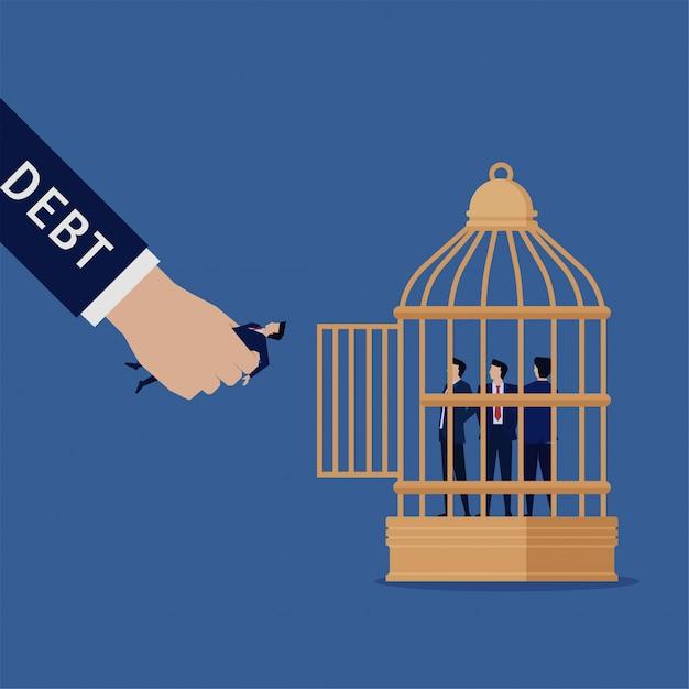 ビジネスの平らな手は、借金のcageの隠phorを置くビジネスマンを保持します。 Premiumベクター