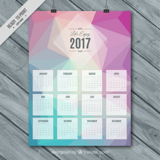Calendar 2017 template with polygonal shapes Free Vector