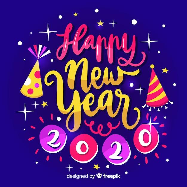Calligraphic happy new year 2020 Free Vector