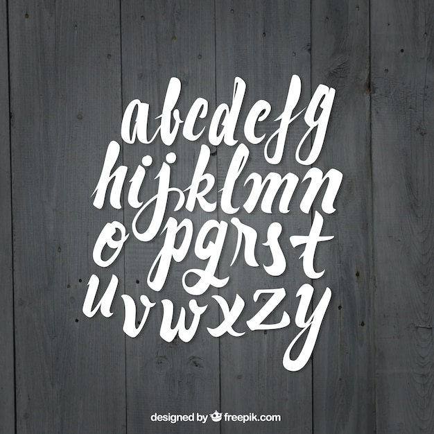 Calligraphy font on wood background Free Vector