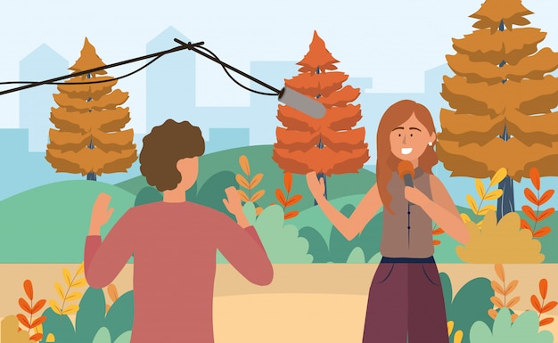 Camera man and woman reporter with microphone equipment Premium Vector