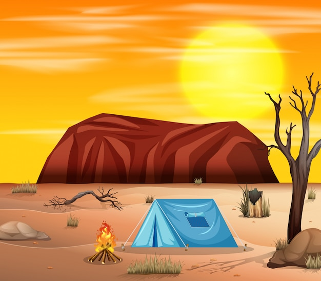 Camping in desert scene Free Vector