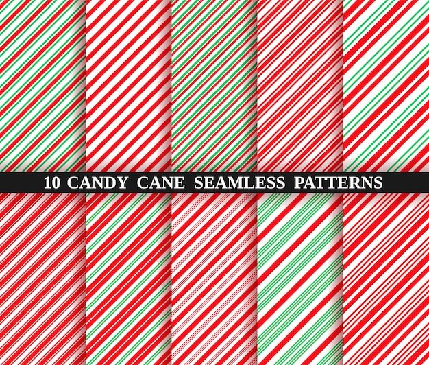 Бесшовный фон полосы тростника конфеты. рождественские текстуры Premium векторы
