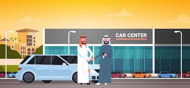 Car showroom background, purchase sale or rental center arab seller man giving keys to owner Premium Vector