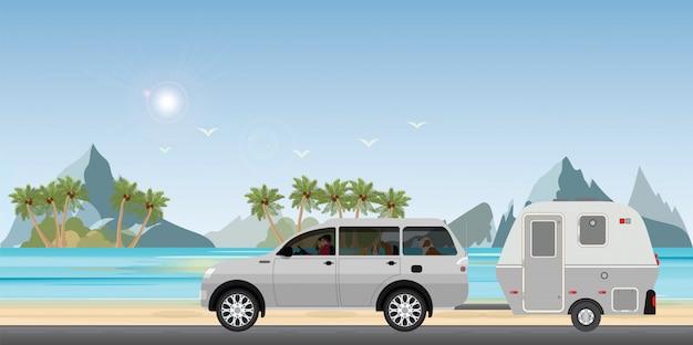 Caravan car driving car on road on the beach.1 Premium Vector