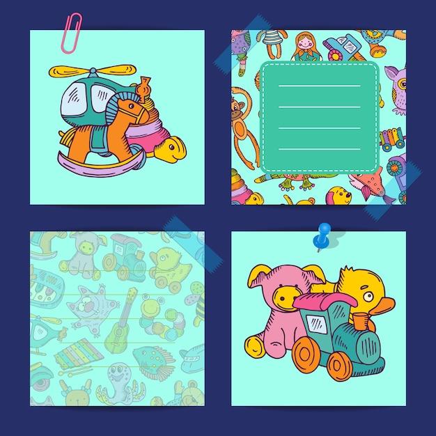 子供の色のおもちゃのイラストで設定されたノートのカード Premiumベクター