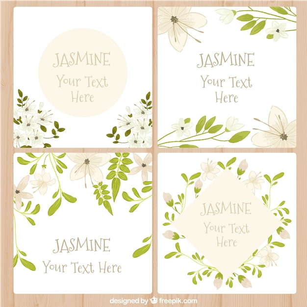 Cards with jasmine design Free Vector