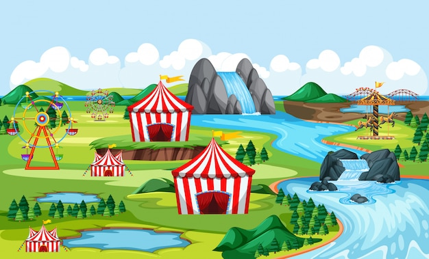 Carnival and amusement park with river side landscape scene Free Vector