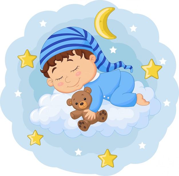 雲の上のテディベアと眠っている漫画の赤ちゃん Premiumベクター