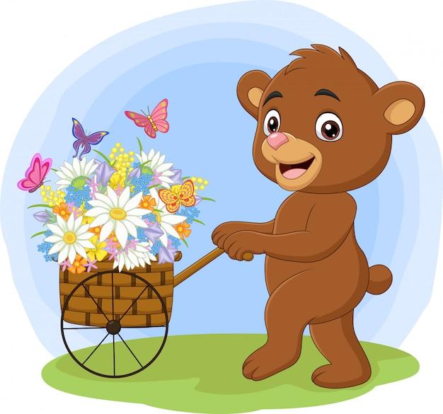 Cartoon bear pushing cart full of flowers Premium Vector