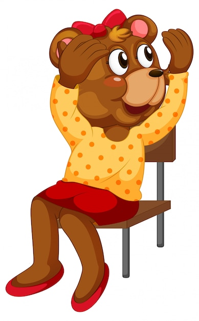 Cartoon bear sitting on chair Free Vector