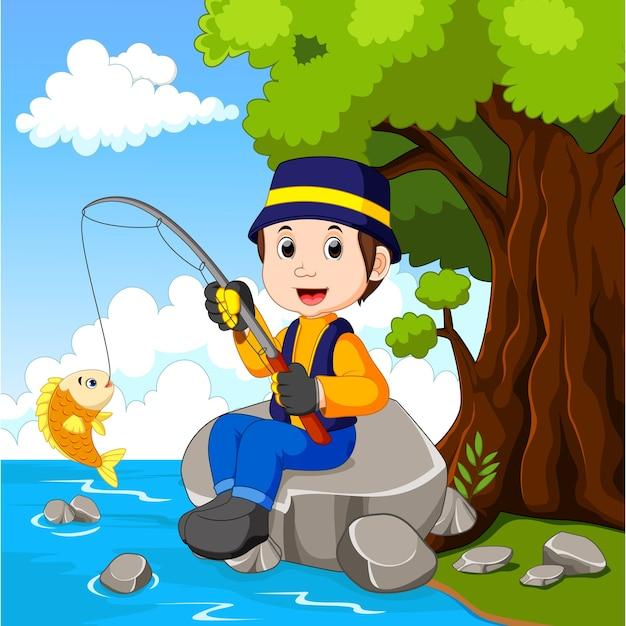 Cartoon boy fishing Premium Vector