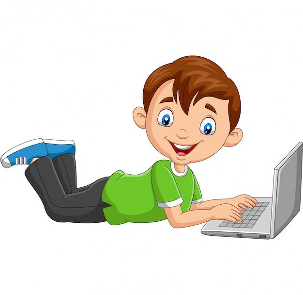 Cartoon boy operating laptop laying on floor Premium Vector