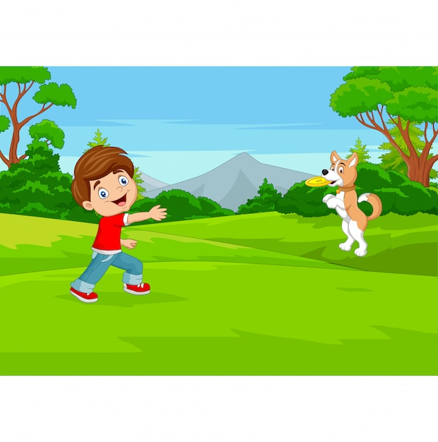 Cartoon boy playing frisbee with his dog in the park Premium Vector