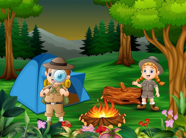 Cartoon of children camping out in the forest Premium Vector