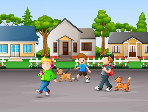 Cartoon children enjoy with their pets at rural house Premium Vector