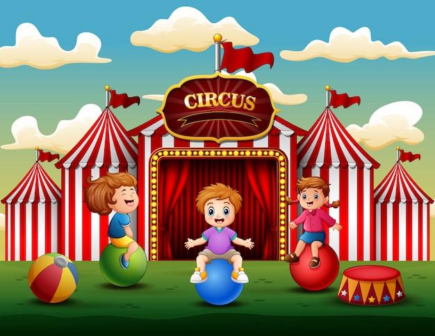 Cartoon children having fun on the amusement Premium Vector