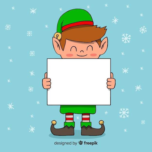 Cartoon elf holding blank sign Free Vector