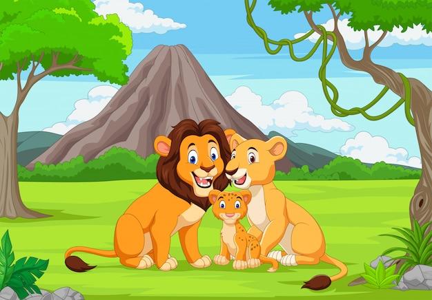 Cartoon family lion in the jungle Premium Vector