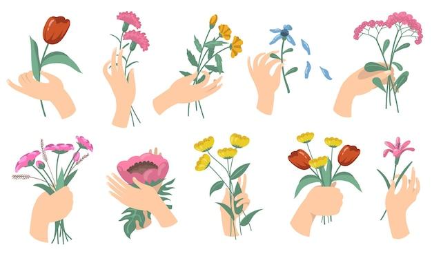 Mani femminili del fumetto che tengono i mazzi di fiori. set di tulipani, garofani, giardino fresco e fiori di campo. illustrazioni vettoriali per fiore, decorazione romantica, concetto di flora Vettore gratuito