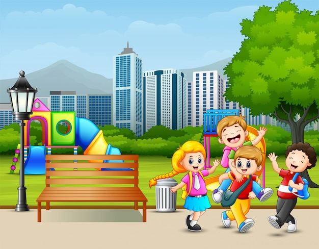 Cartoon happy children playing in the city park Premium Vector