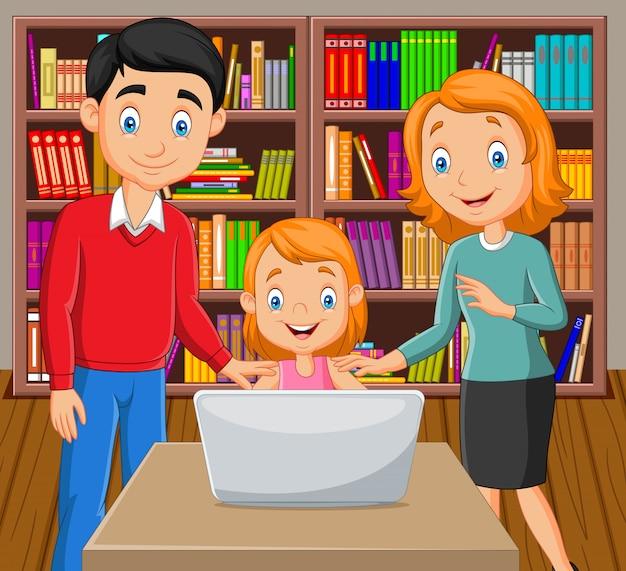 Cartoon happy family watching a laptop Premium Vector