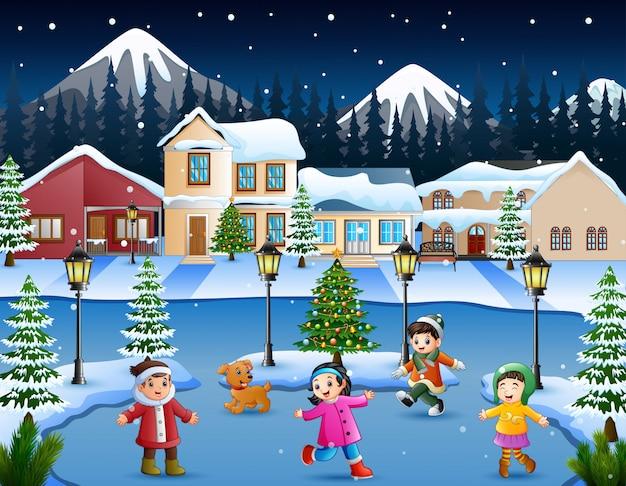 Cartoon of happy kid playing in the snowing village Premium Vector