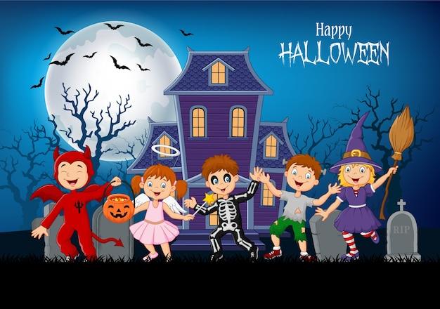 Cartoon happy kids with halloween background Premium Vector