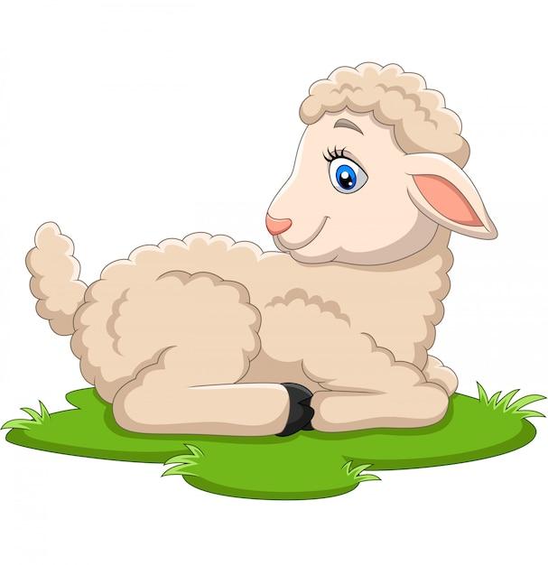 Cartoon happy lamb sitting on the grass Premium Vector