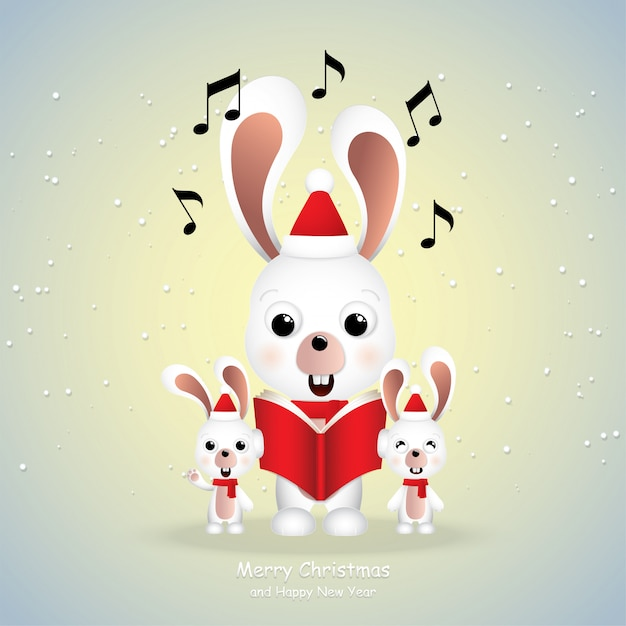 Premium Vector Cartoon Icon Cute Rabbits Singing Merry Christmas
