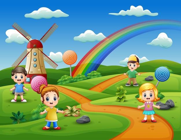 Cartoon kids in a candy land background Premium Vector
