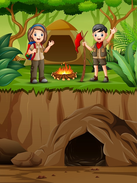 Cartoon kids in explorer outfit camping out in nature Premium Vector