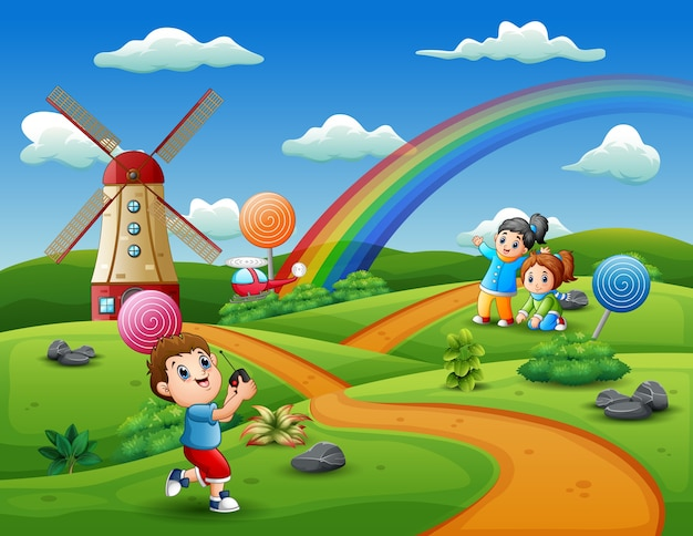 Cartoon kids playing in a candy land background Premium Vector