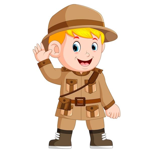 Cartoon little boy scout Premium Vector