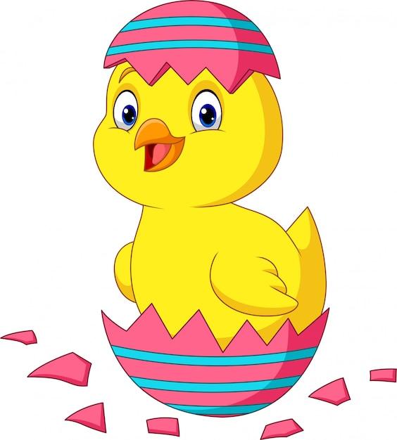 Cartoon little chick hatching from an easter egg Premium Vector