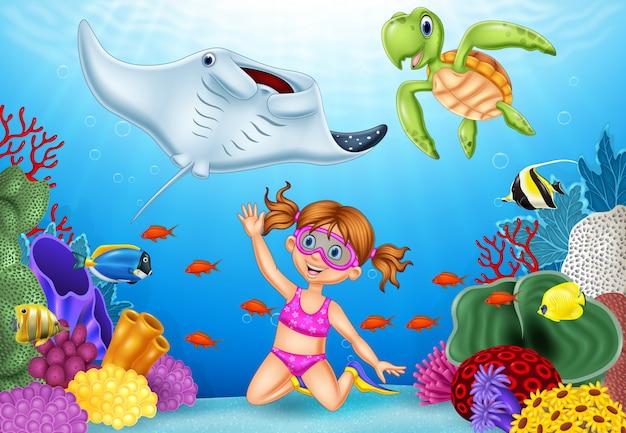 Cartoon little girl diving in underwater tropical sea Premium Vector