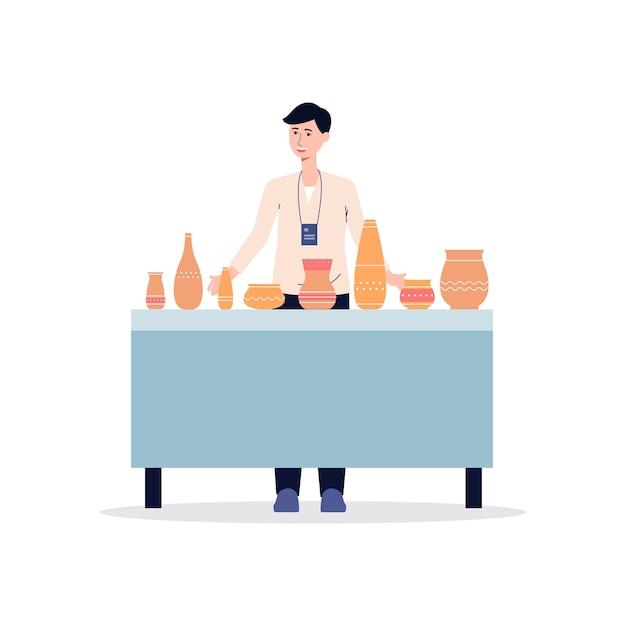 セラミック粘土の花瓶やポットを販売するテーブルの後ろに立っている陶器展で漫画男。手作り食器-イラストと男性の売り手。 Premiumベクター