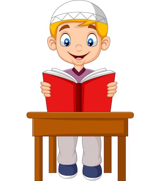 Cartoon muslim boy reading a book Premium Vector