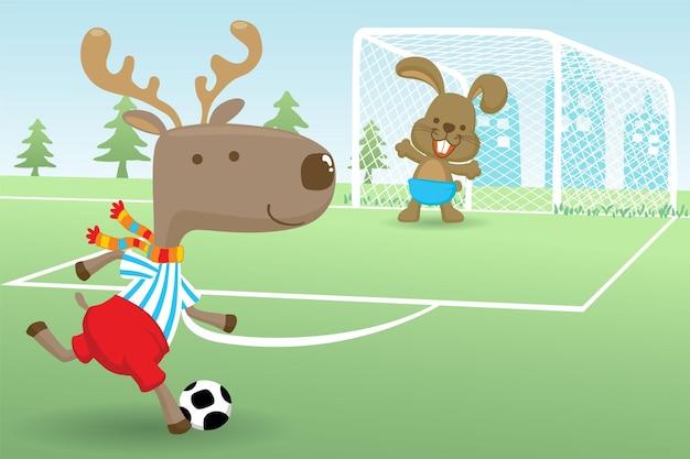 サッカー場でサッカーをしているウサギとヘラジカの漫画 Premiumベクター