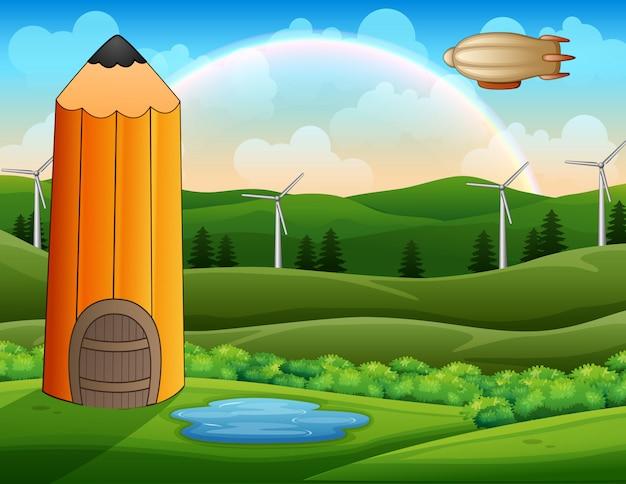 上の飛行船と緑の風景の中の漫画の鉛筆の家 Premiumベクター