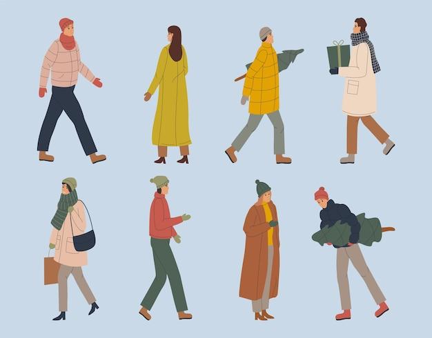冬の服を着ている漫画の人々 Premiumベクター