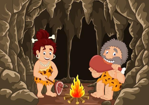 Cartoon prehistoric caveman couple Premium Vector