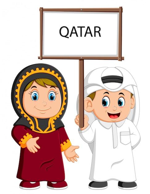 Cartoon qatar couple wearing traditional costumes Premium Vector