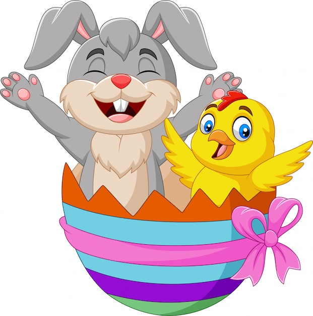 Cartoon rabbit and baby chick inside an easter egg Premium Vector