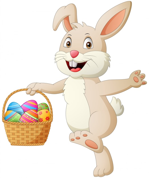 Cartoon rabbit holding easter eggs in basket . illustration Premium Vector