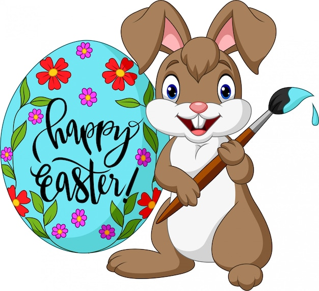 Cartoon rabbit painting an easter egg Premium Vector