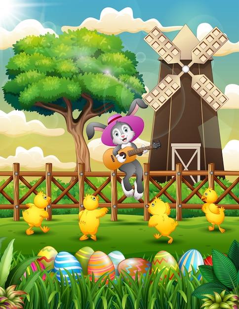 Cartoon rabbit playing guitar on the fence Premium Vector