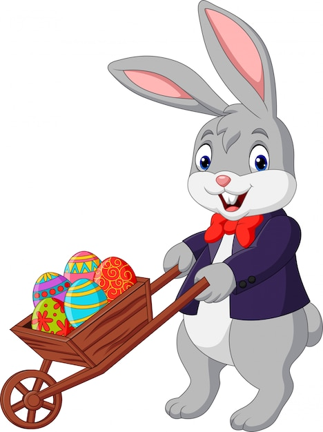 Cartoon rabbit pushing cart full of easter eggs Premium Vector