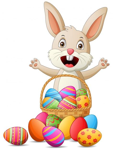 Cartoon rabbit with easter eggs in basket. illustration Premium Vector